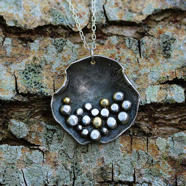 silver and gold sea inspired pendant, handmade by Gemma Tremayne Jewellery