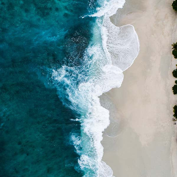 Ocean from above. Beautiful blue sea on white sands