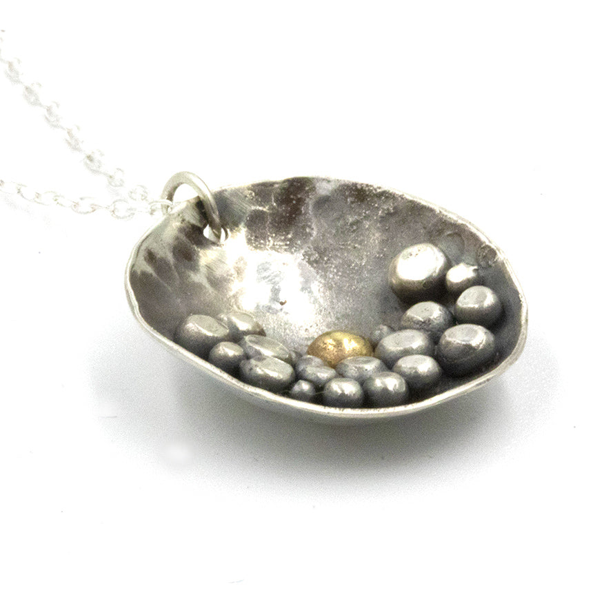 Pebbles on the Beach inspired sterling silver necklace, featuring a deep patina and silver pebble details