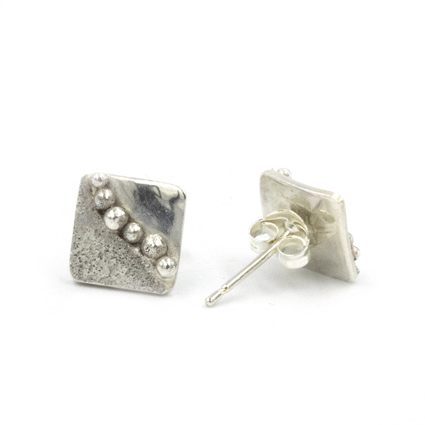 Shoreline stud earrings by Gemma Tremayne Jewellery. Handmade in sterling silver, the earrings feature two beautiful textures each representing sand and sea