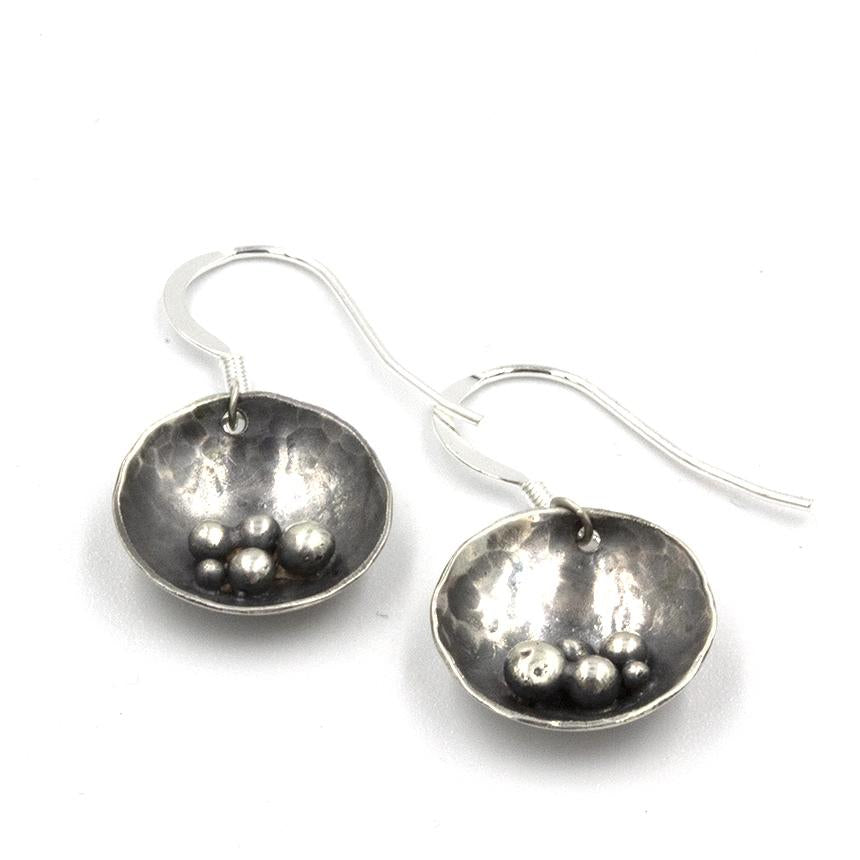 Exclusive 'Pebbles on the Beach' inspired drop earrings, handcrafted in sterling silver, by Gemma Tremayne Jewellery. The earrings features tiny silver pebbles, representing pebbles on the beach, and are perfect for elegant everyday wear.