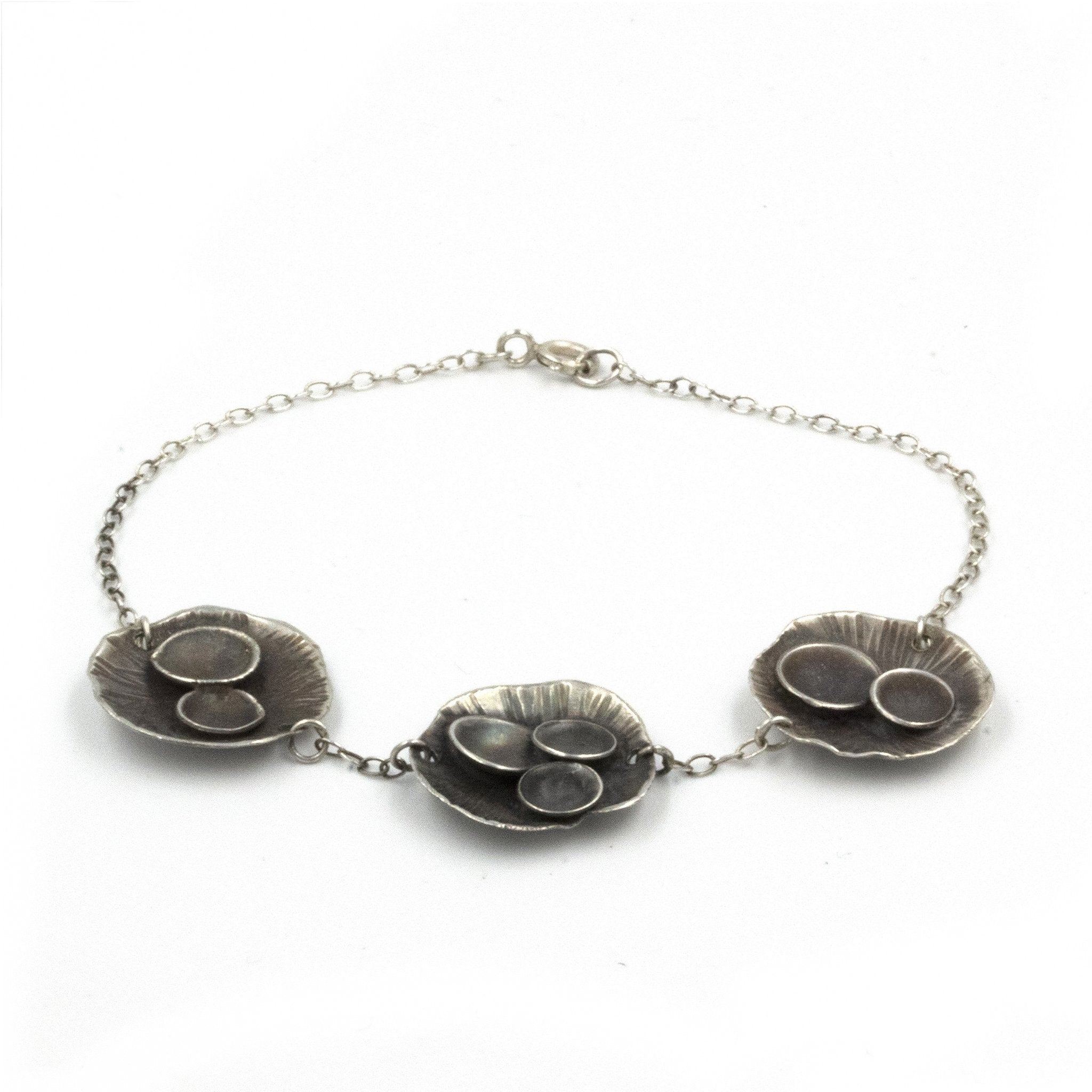 Handmade Rock Pool bracelet, made in sterling silver, and inspired by rock pools on the Cornish Coast