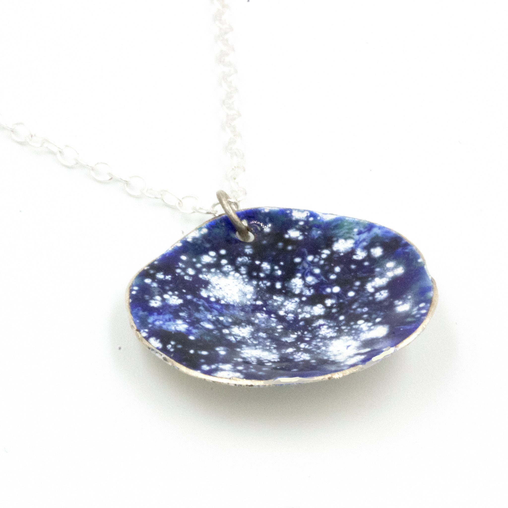 Night sky inspired pendant by Gemma Tremayne Jewellery. Handmade in Fine Silver and Enamels.