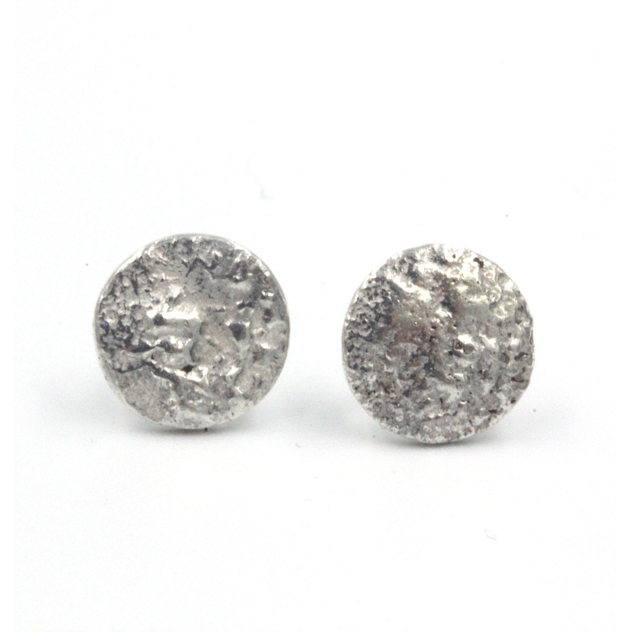 Unique 'Planets' textured stud earrings, handmade in sterling silver these stud earrings are inspired by the planets of our solar system and features a unique textures.
