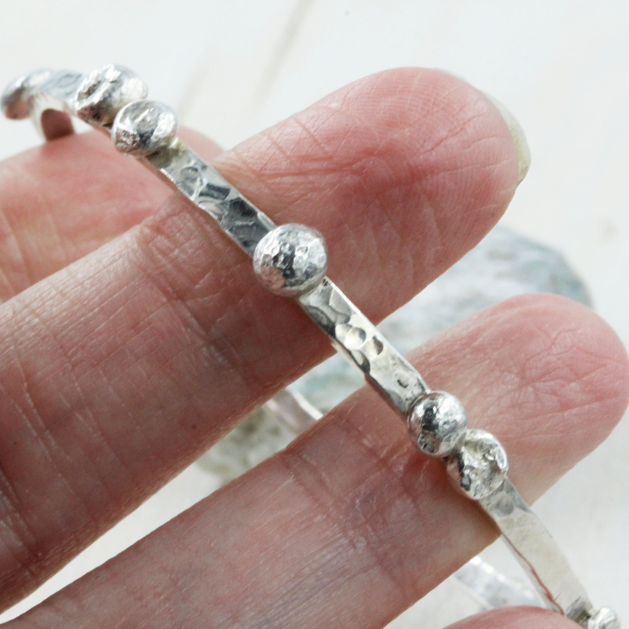 Handcrafted Pebbles on the Beach Bangle, inspired by the pebbley shorelines of Suffolk and handmade in Sterling Silver