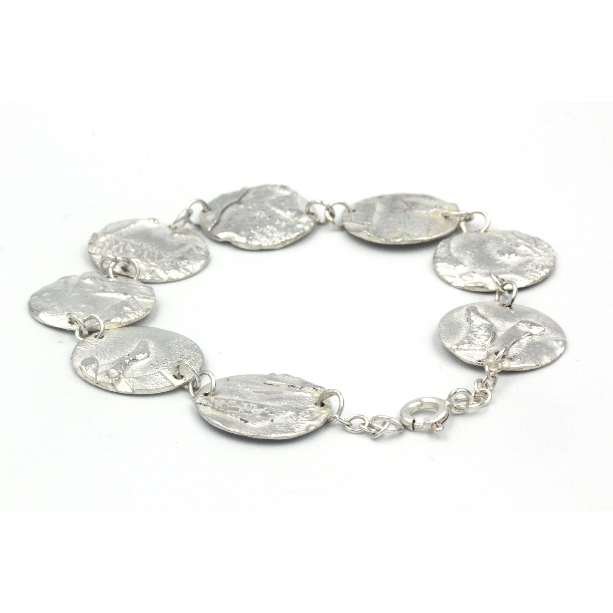 Unique 'Planets' textured bracelet, handmade in sterling silver this bracelet is inspired by the planets of our solar system and features 4 different textures.
