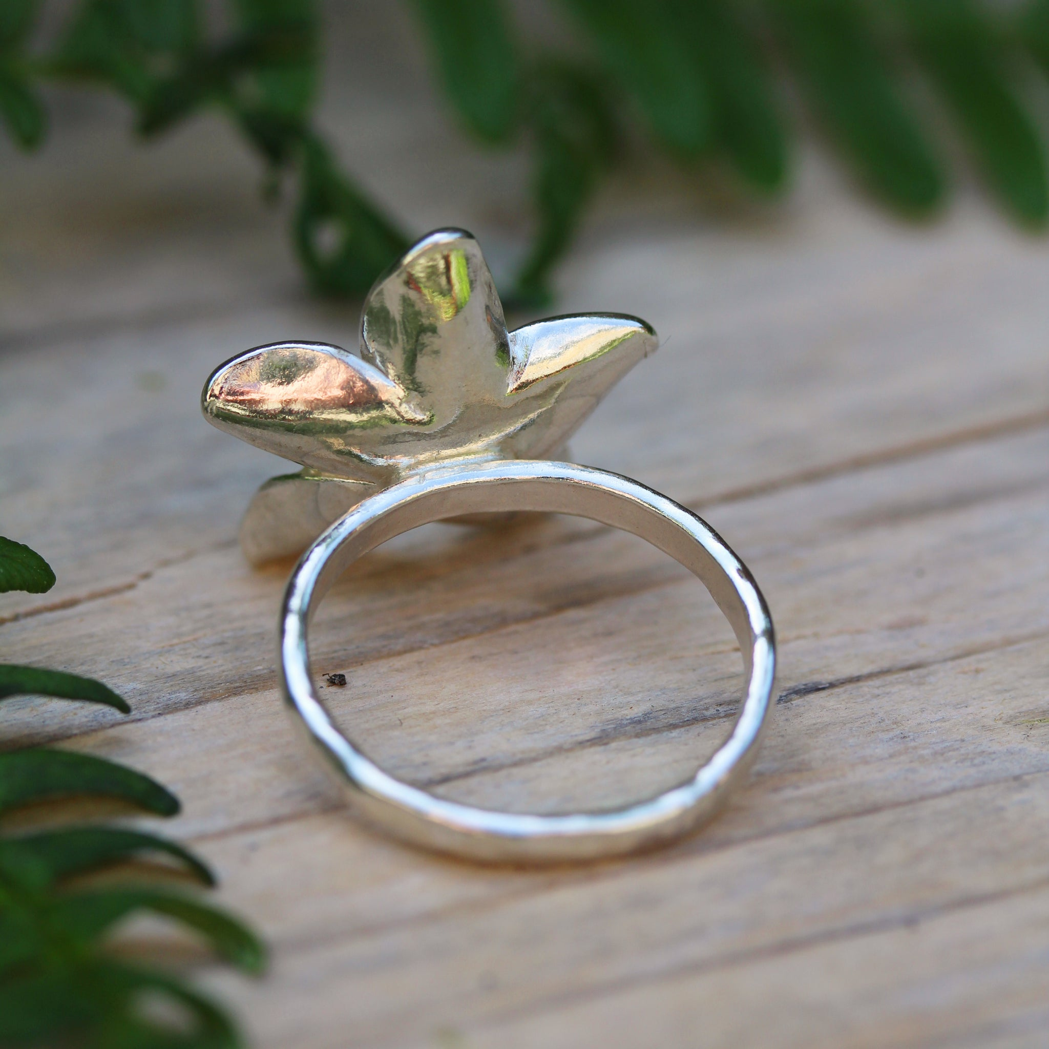Single Plumeria flower ring, handmade in 100% recycled sterling silver, by Gemma Tremayne Jewellery
