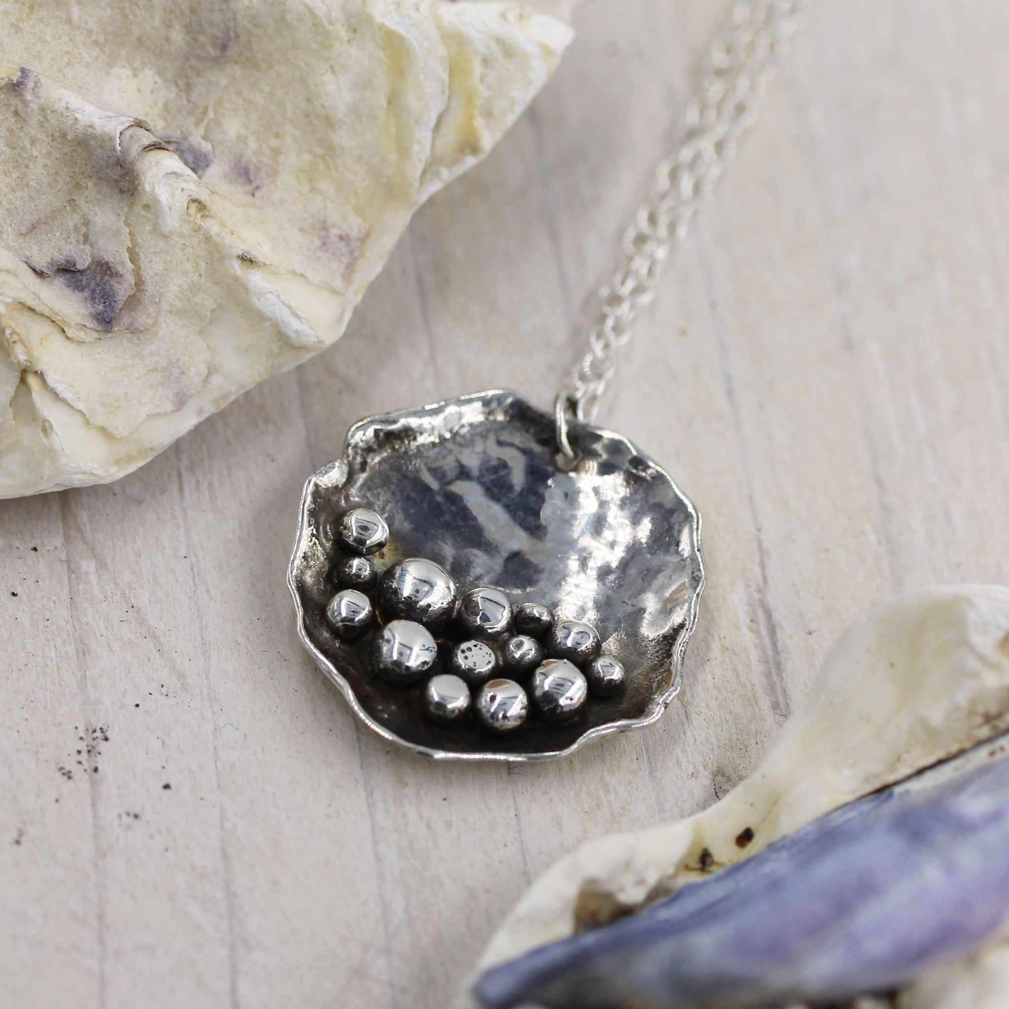 Beautiful handmade 'Pebbles on the Beach' necklace by Gemma Tremayne Jewellery. Handmade in sterling silver, this necklace features sterling silver pebbles, representing pebbles on the shoreline.