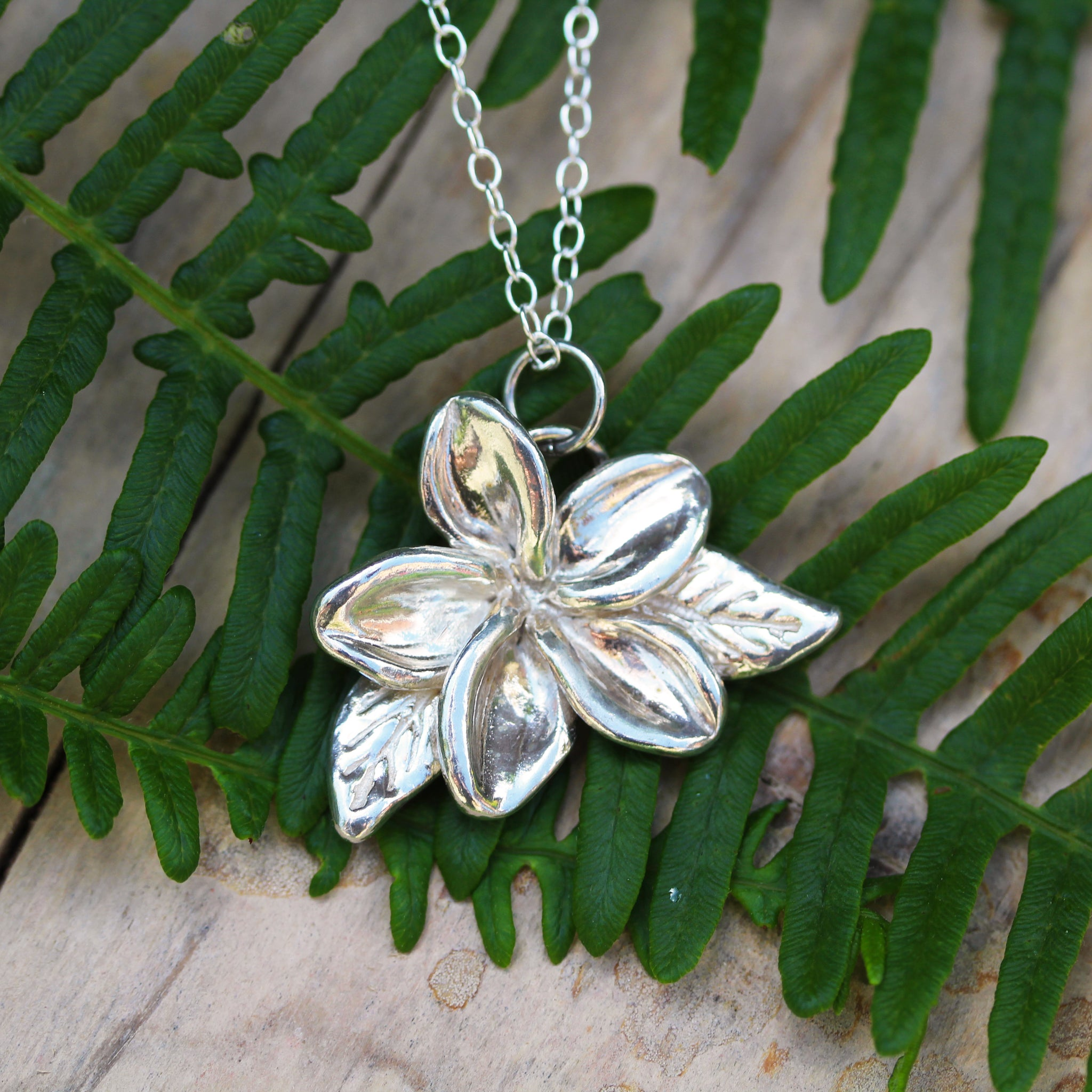 Single Plumeria flower necklace, handmade in 100% recycled sterling silver, by Gemma Tremayne Jewellery