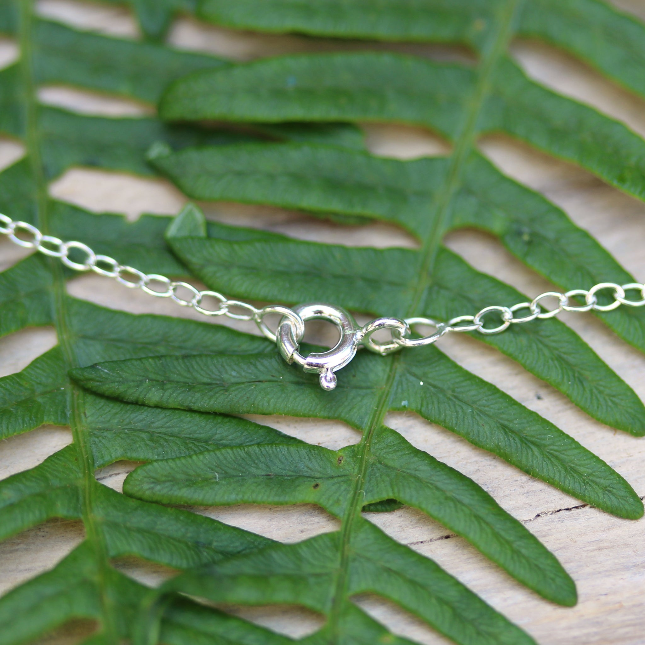 Solid silver bolt ring on the Single Plumeria flower necklace, handmade in 100% recycled sterling silver, by Gemma Tremayne Jewellery