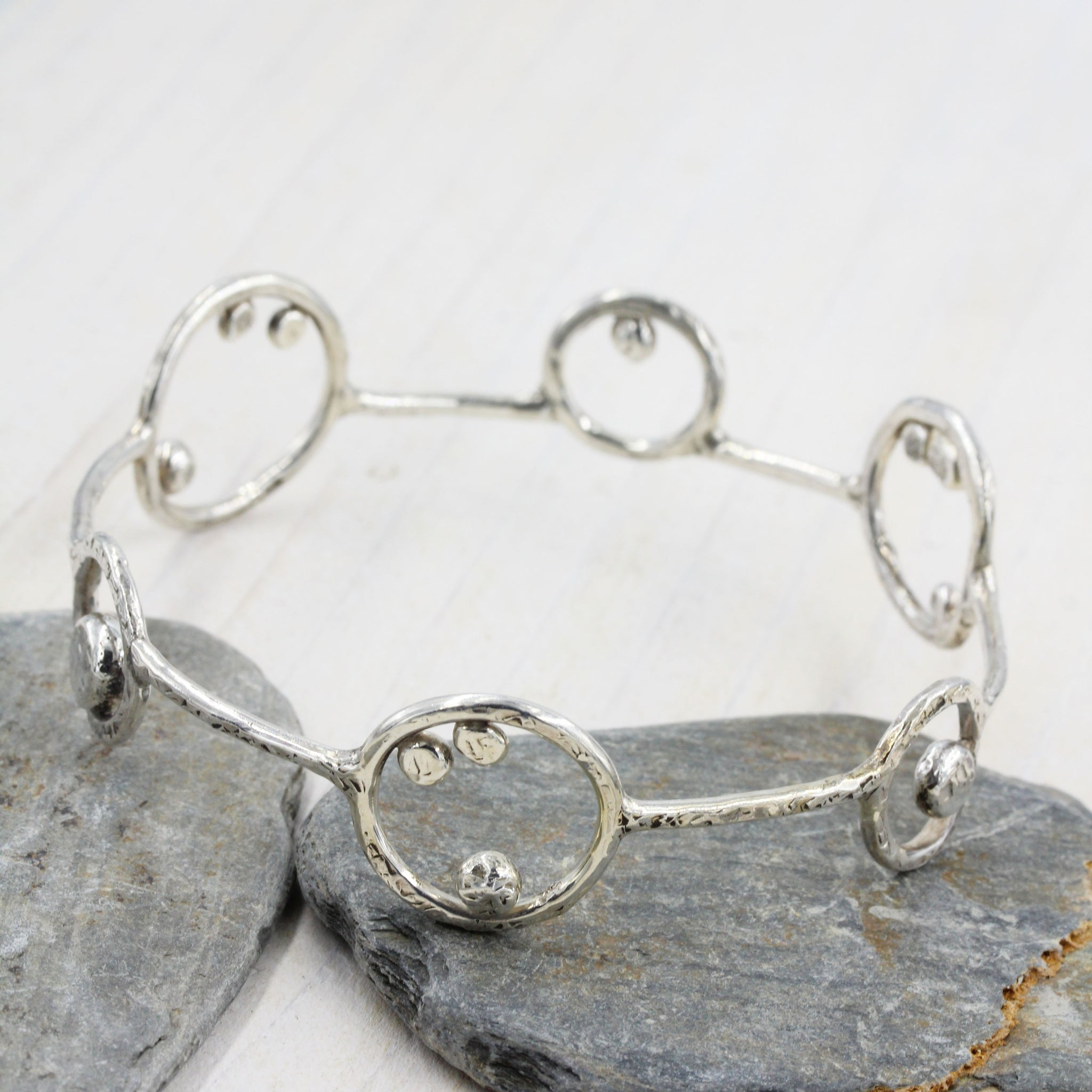 Handmade 'Orbit' Bracelet by Gemma Tremayne Jewellery. Inspired by the solar system.