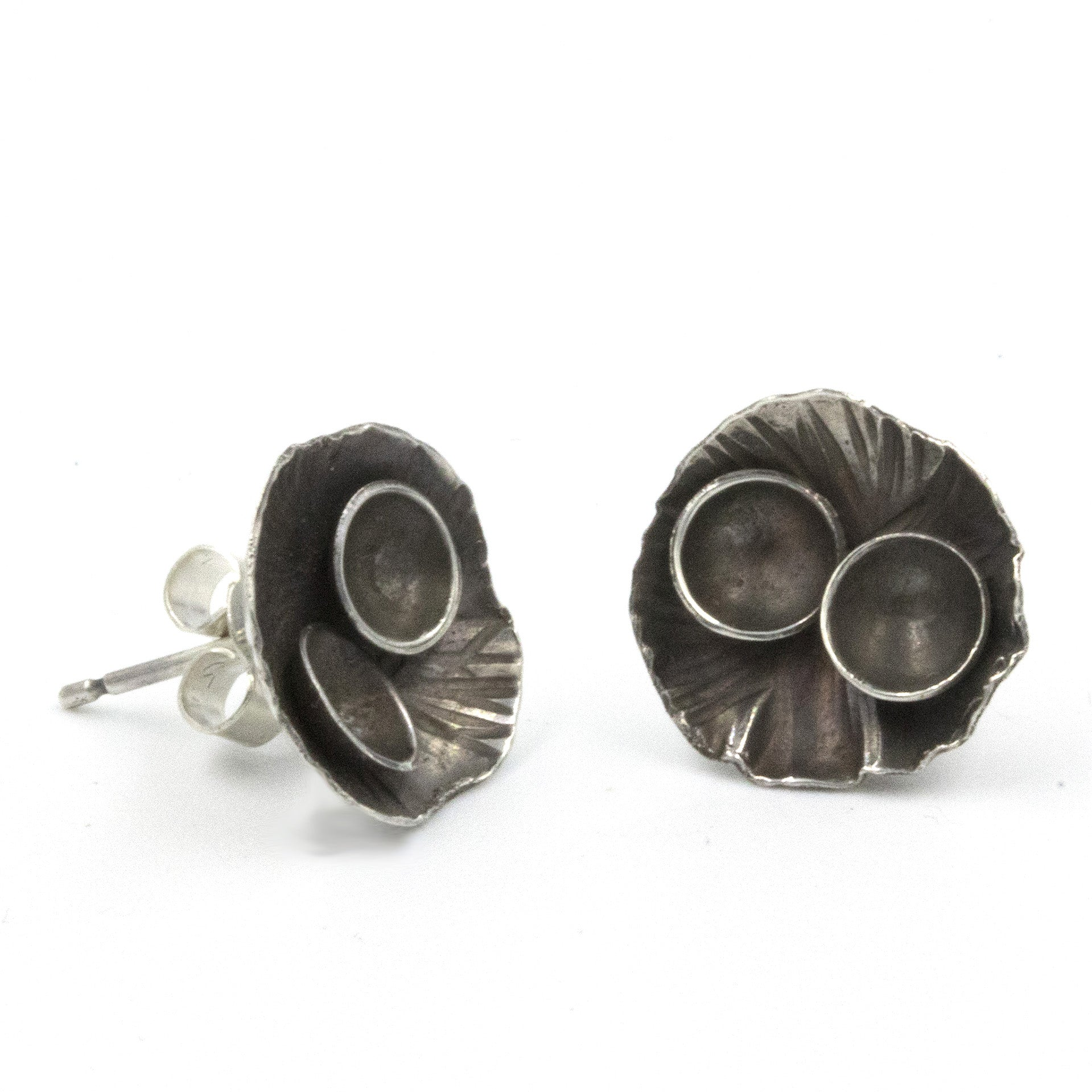 Handmade Rock Pool stud earrings, made in sterling silver, and inspired by rock pools on the Cornish Coast