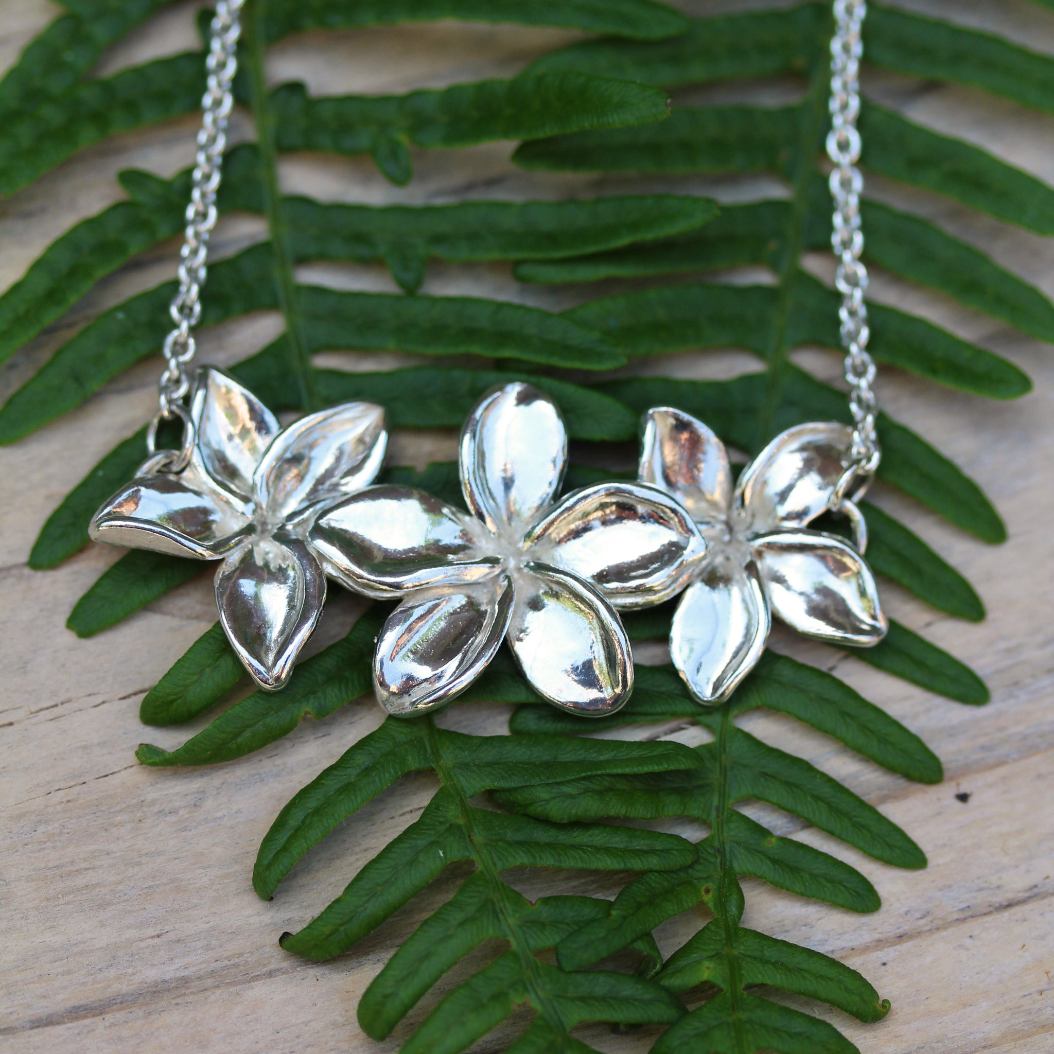 Three Plumeria flower necklace, handmade in 100% recycled sterling silver, by Gemma Tremayne Jewellery