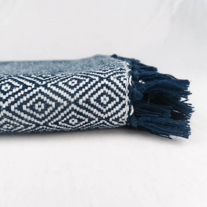 Navy blue cotton blanket modern geometric pattern tassels detail side