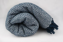 Load image into Gallery viewer, Navy blue cotton blanket modern geometric pattern tassels rolled