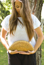 Load image into Gallery viewer, Round woven straw clutch half moon with tassels model front