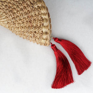 Round woven straw clutch half moon with tassels detail tassels