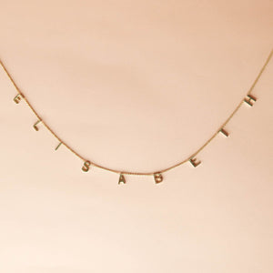Customized Letter Necklace Gold pink background