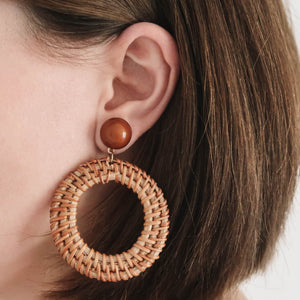 Lotti Rattan Hoop Earrings brown with brown pearl on ear