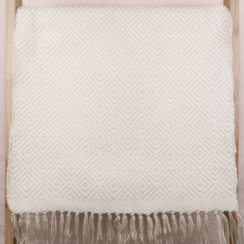 Placemat cotton creme and white with tassles and geometric pattern