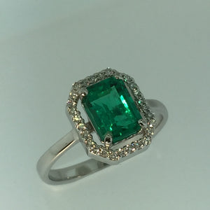 18kw 1.44cts Cert Col Emerald 0.30cts Diamonds ring