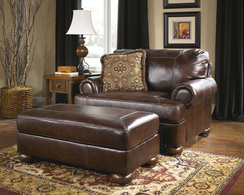 Shop Ashley Furniture Axiom Walnut Ottoman at Mealey's Furniture