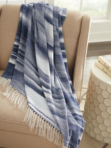 Shop Ashley Furniture Agustin- White/Blue Throw at Mealey's Furniture