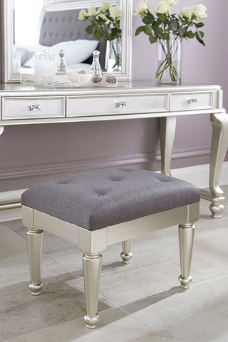 Shop Ashley Furniture Coralayne Upholstered Stool at Mealey's Furniture