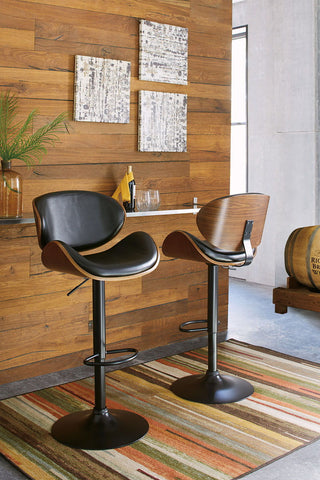 Shop Ashley Furniture Adjustable Height Barstools Tall Uph Swivel Barstool at Mealey's Furniture
