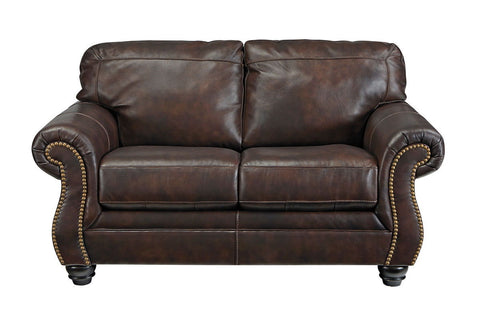 Shop Ashley Furniture Bristan Walnut Loveseat at Mealey's Furniture