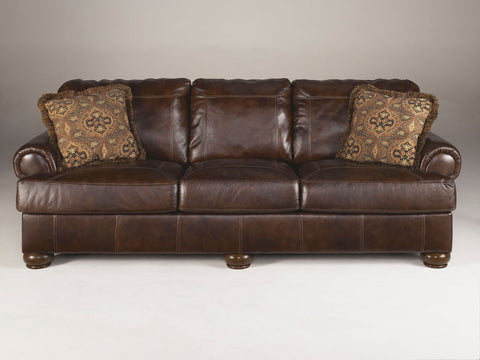 Shop Ashley Furniture Axiom Walnut Sofa at Mealey's Furniture