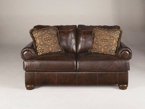 Shop Ashley Furniture Axiom Walnut Loveseat at Mealey's Furniture