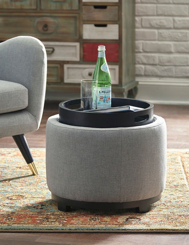 Shop Ashley Furniture Menga Ash Ottoman With Storage at Mealey's Furniture