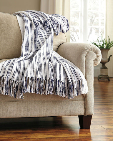 Shop Ashley Furniture Callumn Blue Throw at Mealey's Furniture