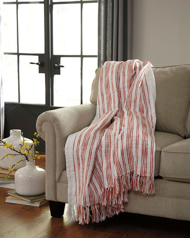 Shop Ashley Furniture Callumn Coral Throw at Mealey's Furniture