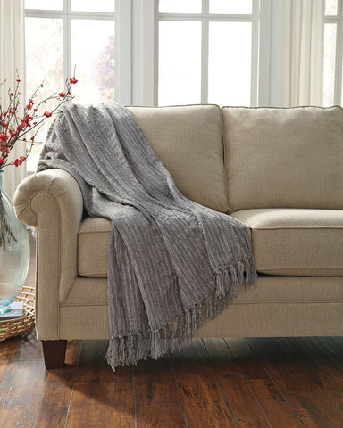Shop Ashley Furniture Noland Gray Throw at Mealey's Furniture