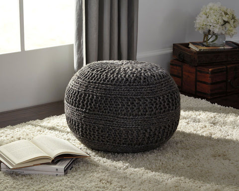 Shop Ashley Furniture Benedict Charcoal Pouf at Mealey's Furniture