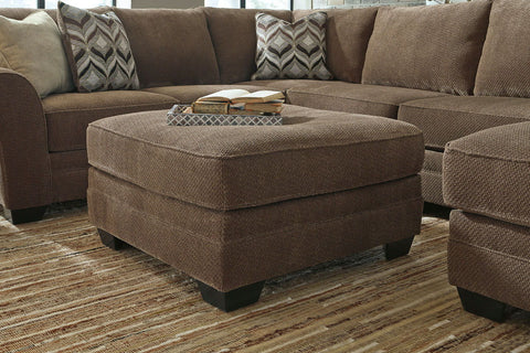Shop Ashley Furniture Justyna Teak Oversized Accent Ottoman at Mealey's Furniture