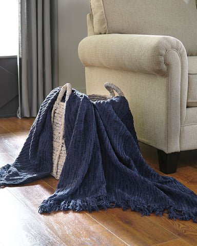 Shop Ashley Furniture Noland Navy Throw at Mealey's Furniture