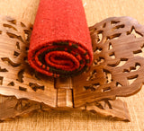 Wool Asana Meditation Mat Shakti red and black rolled.