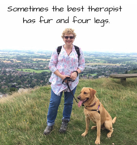 Woman walking a Labrador on the Malvern Hills