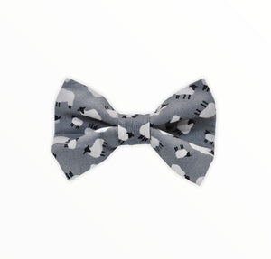 Handmade dog bow tie in cotton print. Made by hand in the U.K. and washable. Silver grey cotton poplin printed with tiny white sheep.