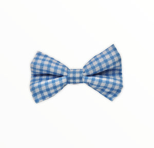 Handmade dog bow tie in cotton print. Made by hand in the U.K. and washable. Blue gingham cotton poplin dog bow tie.