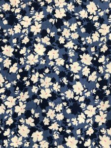 Cotton fabric face mask in a denim blue floral print. Handmade in the UK & washable.