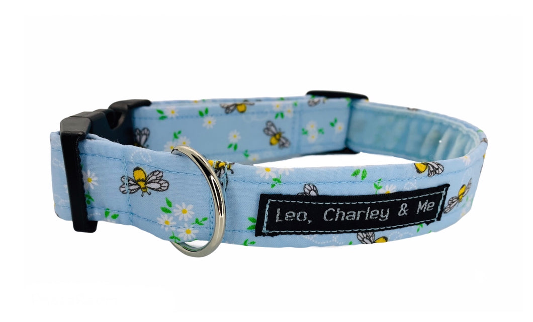 Handmade pale blue dog collar printed with bees .