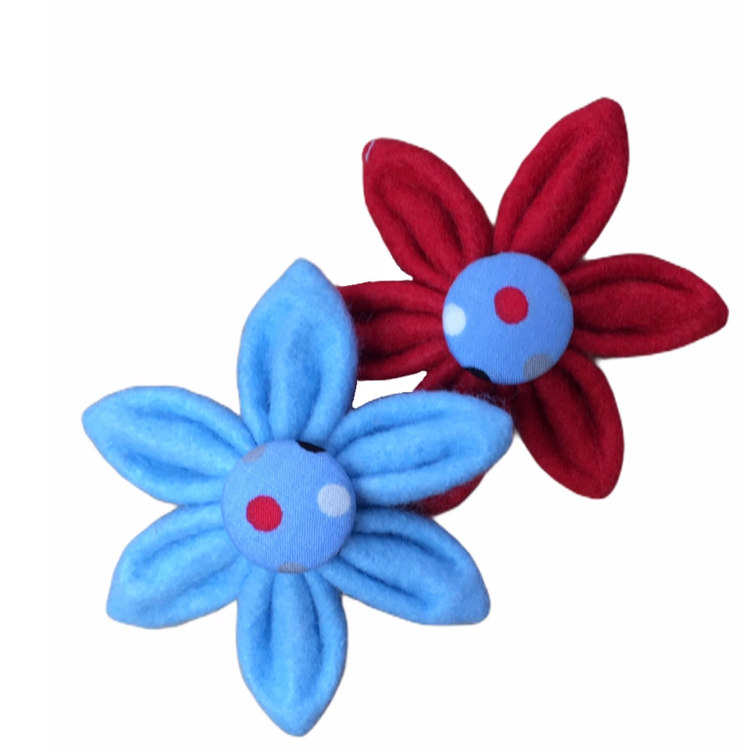 Blue and red felt flowers with co-ordinating blue polka dot button middles. Designed to match the Dotty Blue Dilyn dog collar, lead and bandana. Handmade in the U.K.