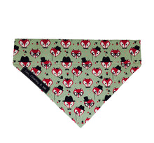 Fabric dog bandana in sage green printed with foxy faces.