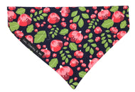 Soft cotton poplin dog bandana with pink fuchsias and green foliage on a navy background. Hand made in the U.K. and washable.