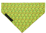 Apple green fabric dog bandana with multicoloured polka dot print. Handmade in the U.K. Washable.