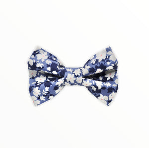 Handmade dog bow tie in cotton print. Made by hand in the U.K. and washable. Denim shades of blue with cream floral print